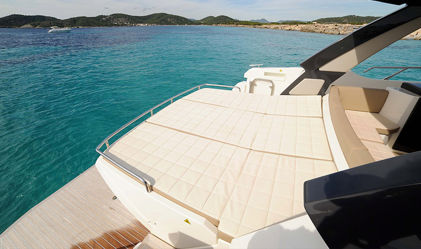 Rear sunbeds of the Absolute 40 Sport Motorboat by Lux Charters Ibiza