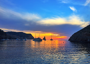 Catch the sunset in Ibiza this summer, go to Es Vedra on the south western tip of the island to the red sky at night
