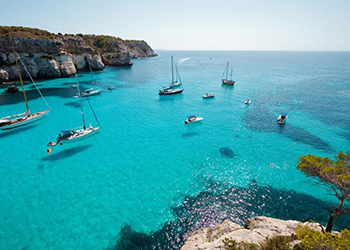 Dive into the blue waters of Formentera from your private charter boat